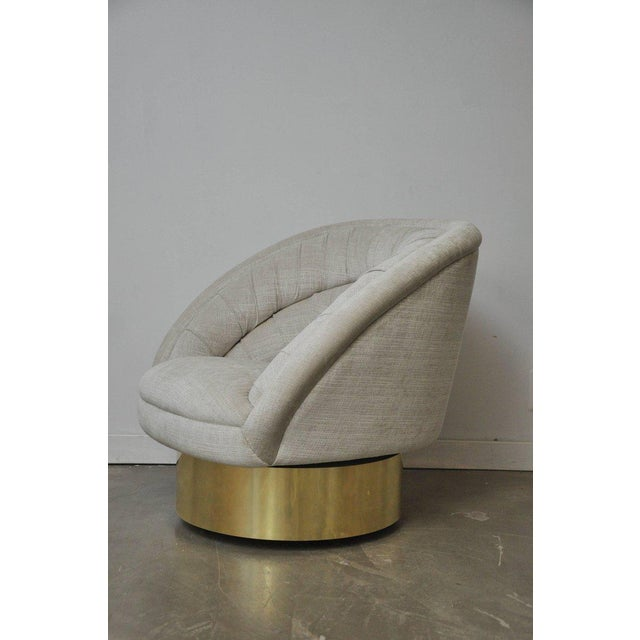 Gorgeous swivel chair by Vladimir Kagan. Fully restored and reupholstered.