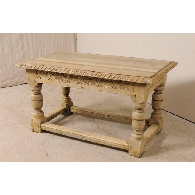 French 19th century wood table with intricate carvings and gold