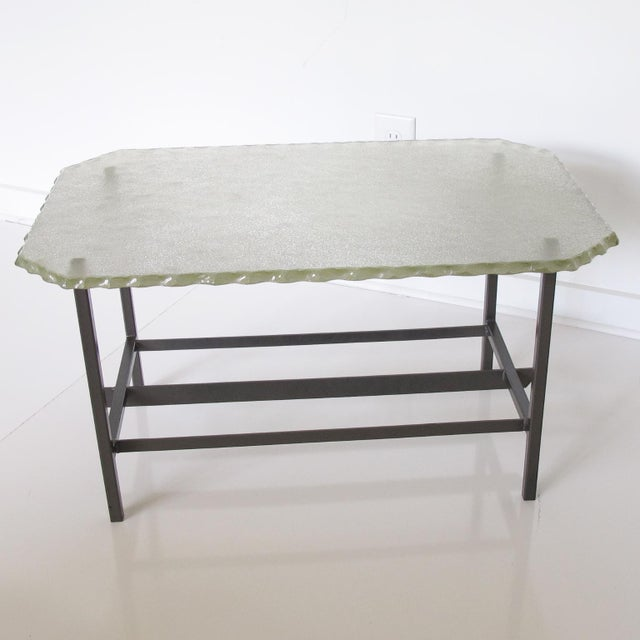 Exquisite Mid-Century modernist glass and metal coffee table attributed to the renown Italian manufacturer Fontana Arte....