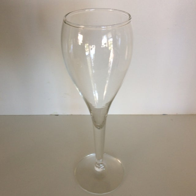 Modern tulip style crystal champagne glasses are made by Crisa in Mexico and are all hand blown This is the medium size of...