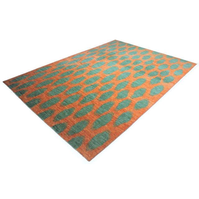 Beautiful handmade Ikat rug, by Aara Rugs. It's a rug with modern design and beautiful orange and green colors, dyed with...