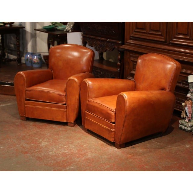 These Classic, antique Art Deco club chairs were crafted in France, circa 1920. The stately, masculine chairs feature...