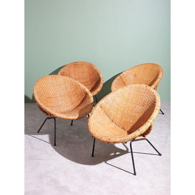 Vintage circa 1960s American wicker basket chairs with iron legs. Perfect chairs for your covered outdoor patio or inside...