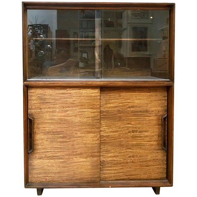 1950s China hutch designed by Milo Baughman for Drexel Perspective. Made of Mindoro wood, the hutch has two sliding glass...