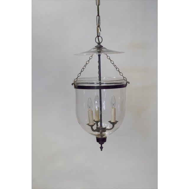 This handblown Regency lantern is perfect for a variety of spots such as foyer, powder room, dining room or kitchen...
