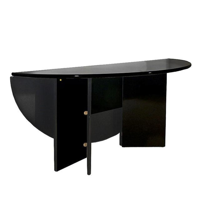 """Antella"" foldable table or console, frame and top with rounded front edge, two hinged elements held together by a magnet,..."