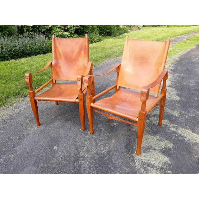 This is a pair of vintage safari chairs designed by Wilhelm Kienzle for Wohnbedarf. The chairs were designed in the 1920's...