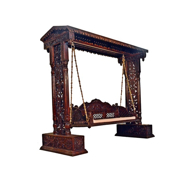 """This Royal Indian Jhula Swing is exquisitely handcrafted by Skilled Indian Craftsman. This crafted wooden swing is a..."
