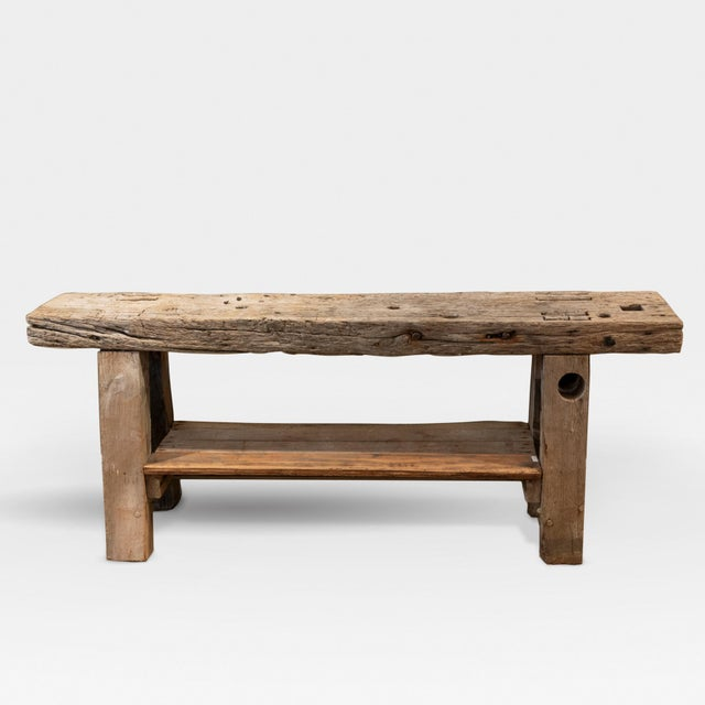 A narrow rustic pine workbench with a single shelf, French, Circa 1890 height: 28 in. 71 cm., width: 70 in. 178 cm.,...
