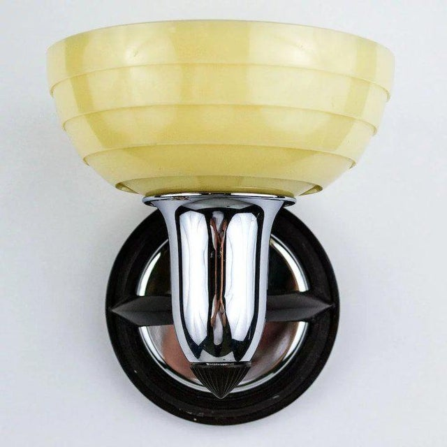 A great 1930's Art Deco single light sconce featuring original cream colored step slip shade. Glass, chrome plating and...