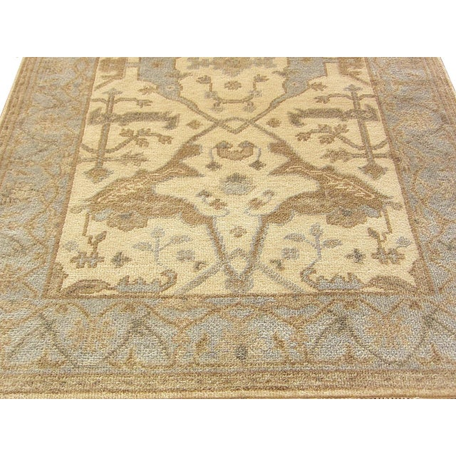 This listing is for an Indian Oushak rug. The rug pattern colorways are in blue & ivory with a traditional design. Type:...