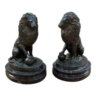 Antique Bronze Sculpture Sitting Lions With One Front Paw Resting on Ball - a Pair For Sale