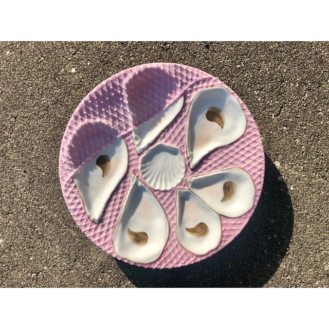 Vintage pink and white ceramic oyster plate. Hand-painted, with space for six oysters. Stunning condition.