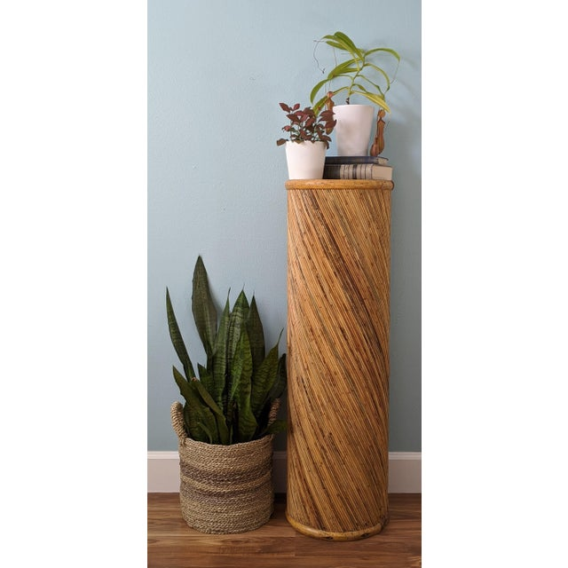 Large and impressive column plant stand. Lovely pattern of pencil bamboo curved around a wooden frame with halved bamboo...