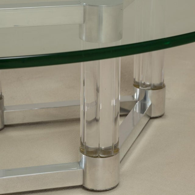 An aluminium framed coffee table in a diamond shape with chunky cylindrical lucite columns 1970s Base dimensions H:40cm...