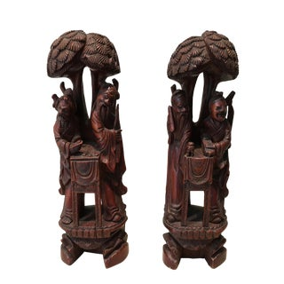 Carved Wood Figurines - A Pair For Sale