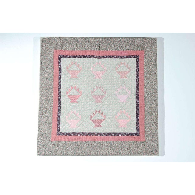 This finely pieced small crib quilt has such great Calico fabrics of great pastel colors. The condition is very good and...