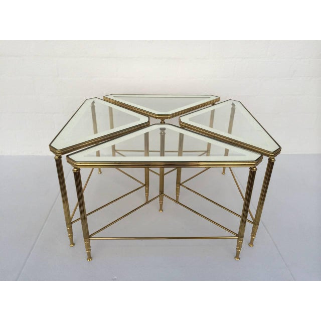 "A set of four brass with glass inset tops that have a 2"" mirror border around the edge (see photos) These tables can be..."