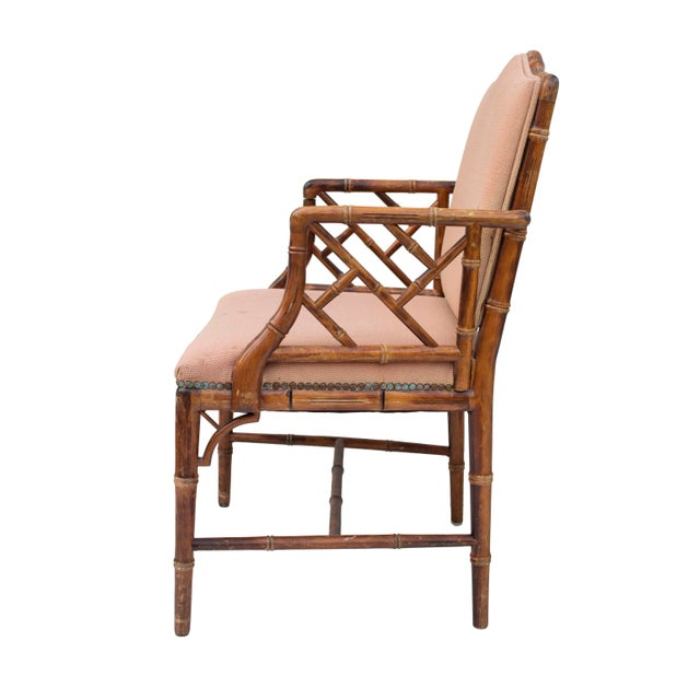 Set of four Chinese Chippendale-style Hollywood regency dining chairs with faux bamboo frames. These have a lattice back...