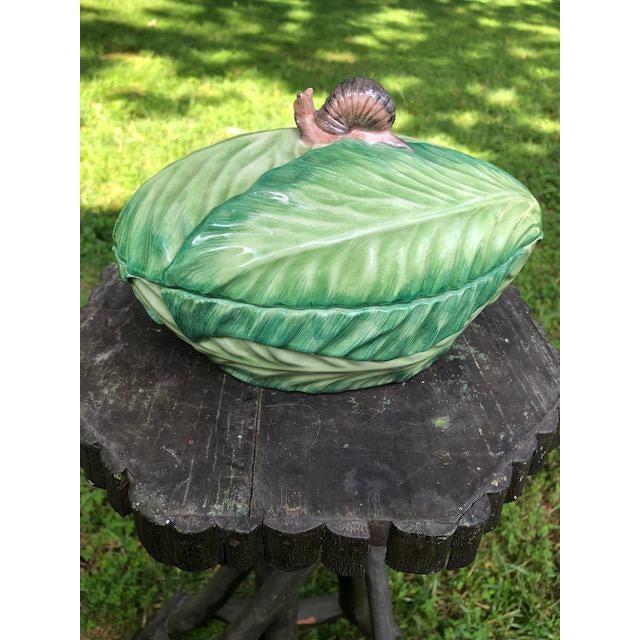 Adorable Mottahedeh snail and cabbage tureen. A sweet piece to display in any country kitchen.