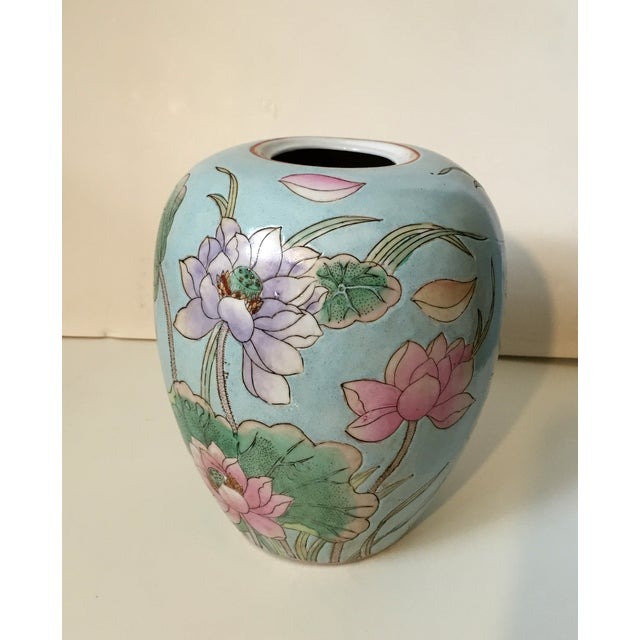 Tall Chinese light blue vase with incised waterlily pattern