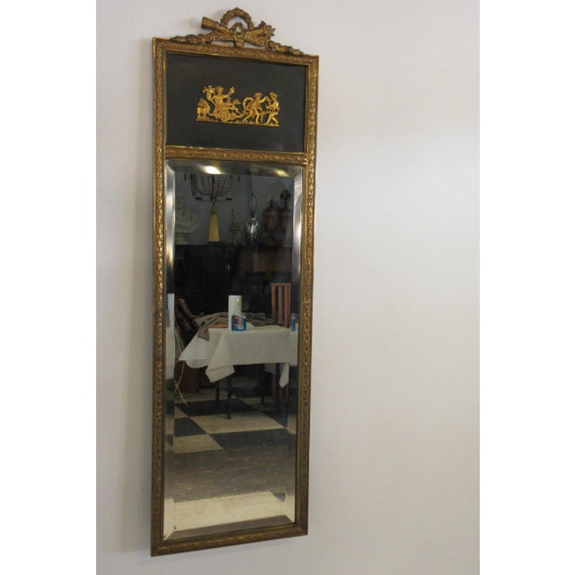1950s French classical trumeau mirror. The entire frame is made of brass. Purchased from a NYC penthouse apartment.