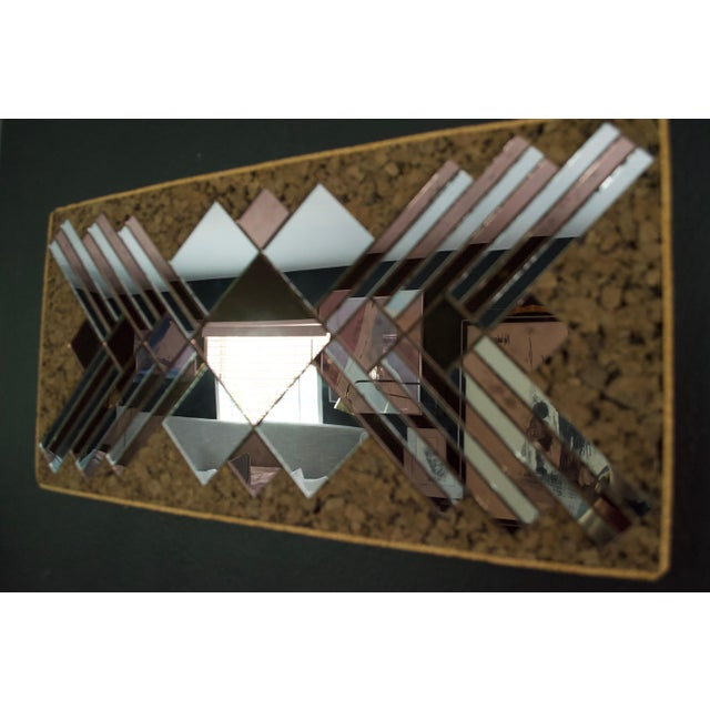 Stunning rose and silver mirrored wall sculpture on cork with abstract diamond and chevron design. Each piece is hand cut,...
