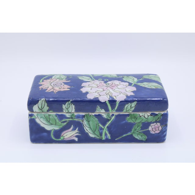 A superb antique hand painted Asian ceramic floral box adorned with pink peonies. The shade is a lovely cobalt blue with...