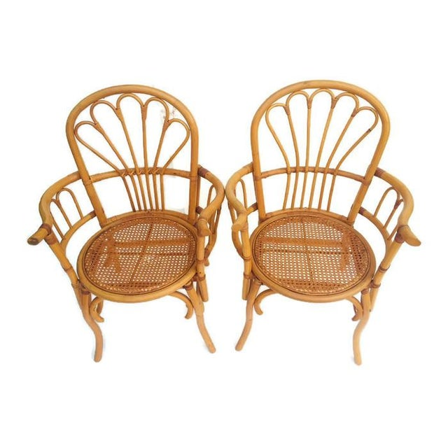 Vintage Bent Bamboo Chairs, Rattan Peacock Style Arm Chairs, Franco Albini Style Bamboo & Rattan Bistro Chairs. These can...