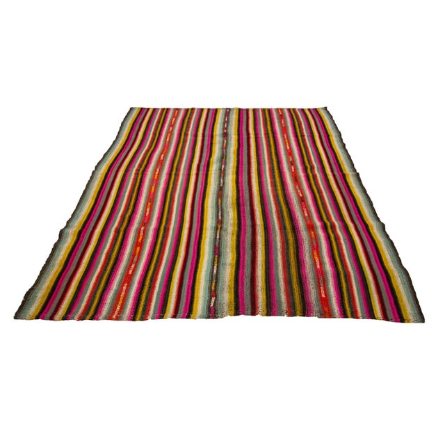 Colorful striped vintage handwoven kilim rug from Denizli region of Turkey. Approximately 45-55 years old. In very good...