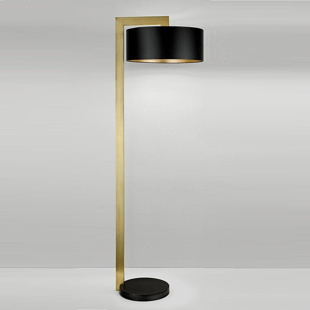 Art deco style lamp in black bronze and English brass. A circular base with a stepped detail. Linen shallow shade with an...