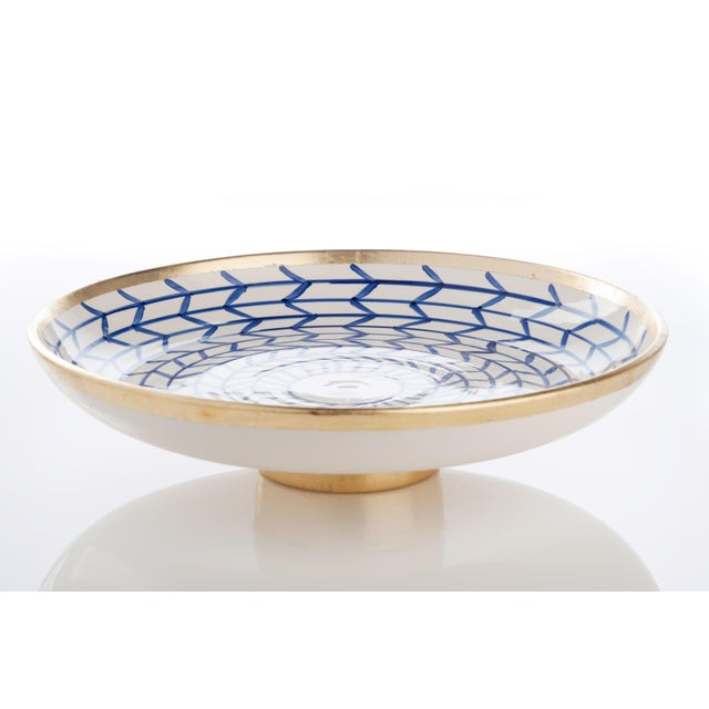 This distinctive decorative plate with a crisp blue and white geometric design trimmed in gold is a stunning addition to...