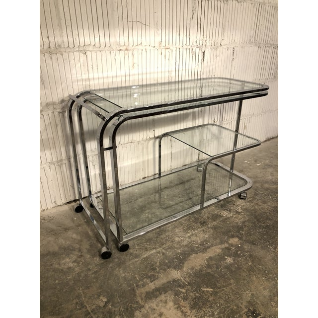 Amazing condition - chrome swivel bar cart by DIA, often attributed to Milo Baughman. This cart is a generous size, which...
