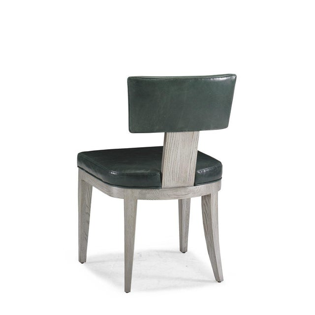 The Freeport Dining Chair A handsome and comfortable side chair constructed of oak solids and veneers in a metallic silver...