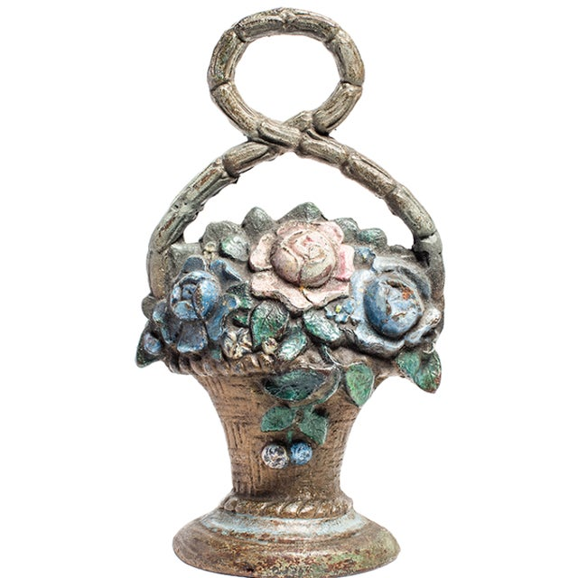 Cast iron door stop with a flower basket design. Circa 1880.