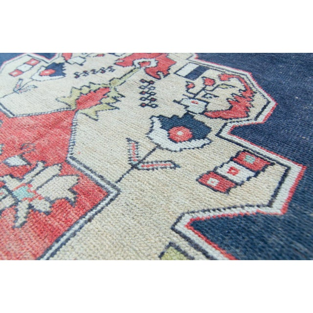 This striking rug features a center medallion with the backdrop of colors such as salmon, gray, yellow, green, and...
