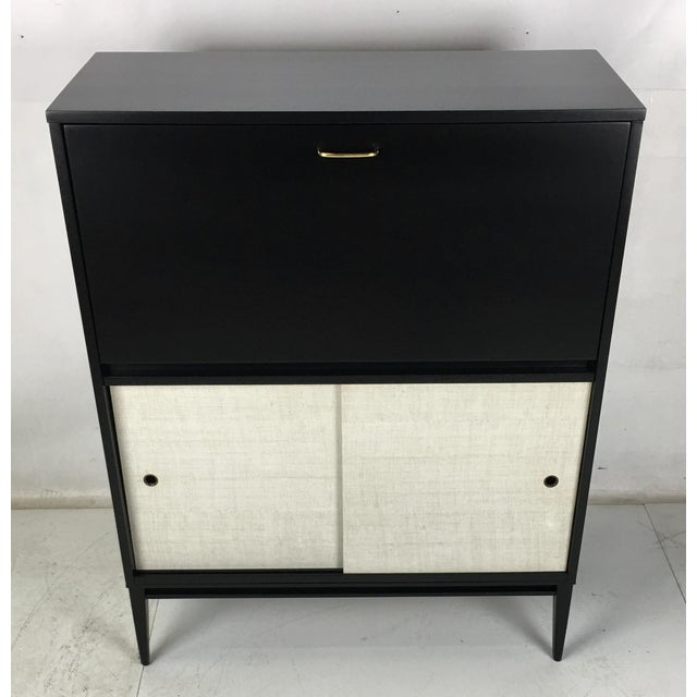 Up for bid is this handsome drop-front secretary from the Planner Group by Paul McCobb for Wichendon Furniture. The piece...