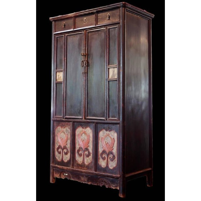 Dated to early 19th century Chinese lacquer tall cabinet with flower panels and dream stones inset. It has 3 drawers. all...