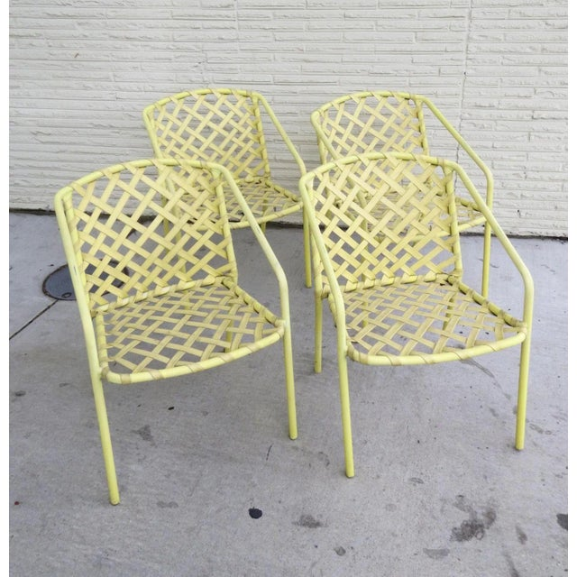 """Vintage Brown Jordan strap chair in yellow. Measure 21"""" by 24"""" by 28"""". Has normal wear. Last photo shows with table we..."""