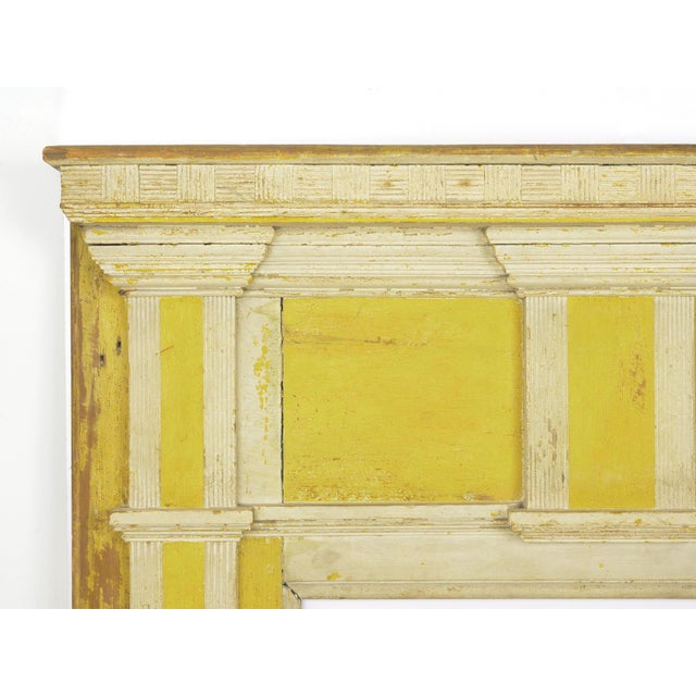 A fine Federal style fireplace surround retaining early yellow and white paint, this is a rare find with its diminutive...