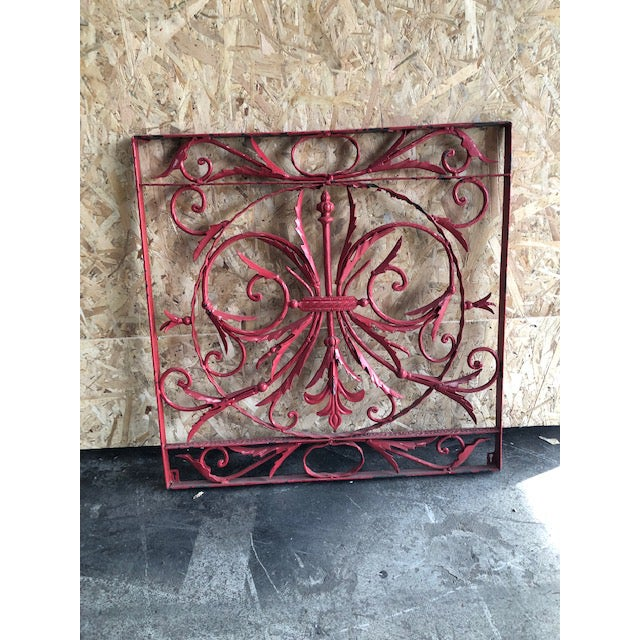This wrought iron decorative grill was handmade in France. The scrolled design in covered in the original red paint with...