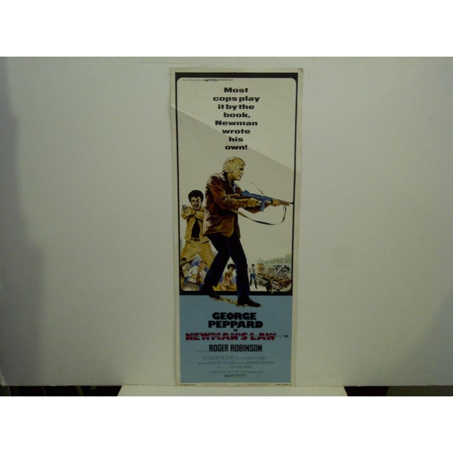 """A vintage movie poster """"Newman's Law"""", starring George Peppard. Copyright 1974 Universal Pictures. The poster is in good..."""