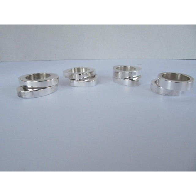 Beautiful set of 8 mixed shapes, silver-plate napkin rings. Includes 2 of each, circle, square, oval, triangle. Some wear...