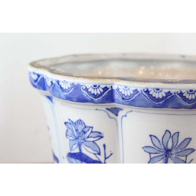 Hand painted blue and white Chinese porcelain planter with Lotus pattern details.