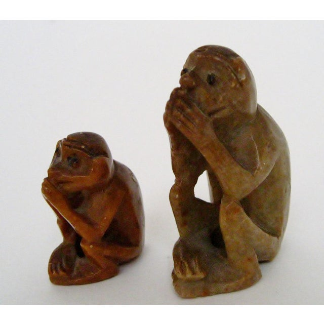 """A pair of mini hand-carved stone monkeys in two sizes. No maker's marks. Smaller, 0.6""""W x 1""""D x 1.25""""H. Larger monkey has..."""