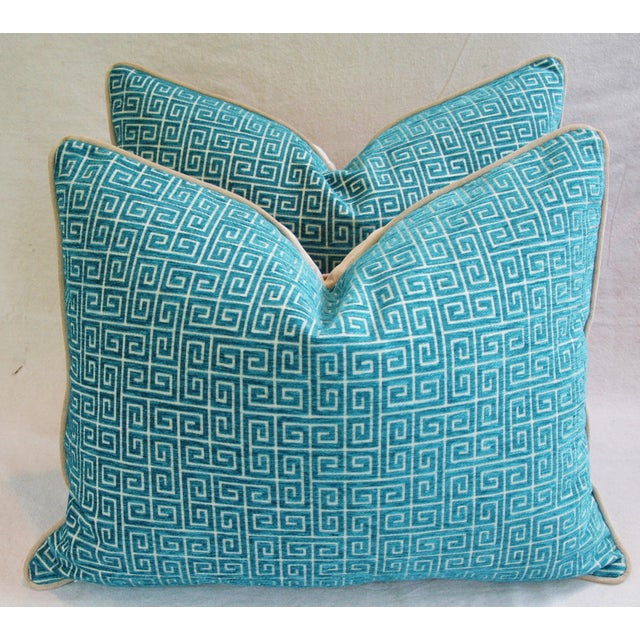 Pair of large custom-made pillows in a contemporary turquoise colored velvet Greek key fabric. Pillows backs are a ultra...