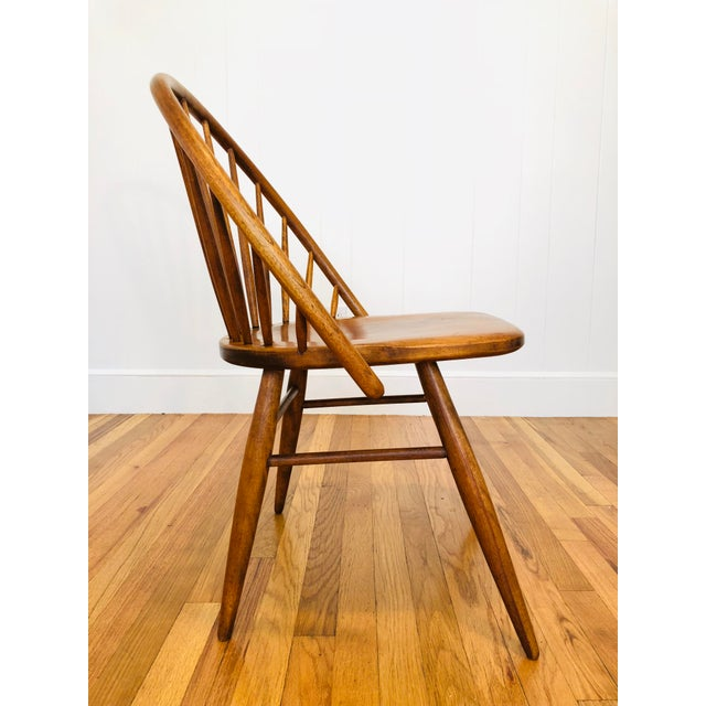 Rare pair of Mid Century Russel Wright for Conant Ball Maple Windsor style chairs. Really cool full arched backs make...