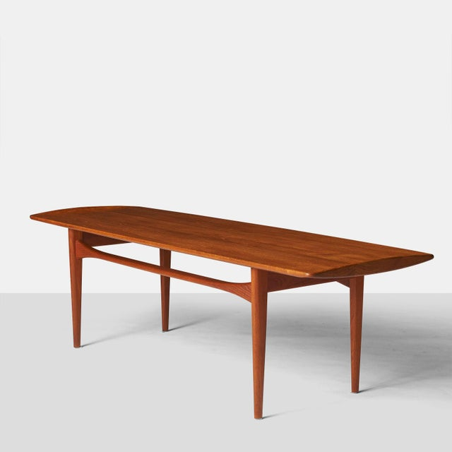 A coffee table in teak, produced and labeled by France & Daverkosen.