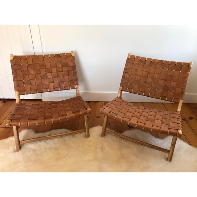 Beautifully crafted, woven leather lounge chairs. Rich brown leather with solid wood frame. They have never been sat in...