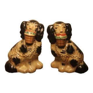 Early 20th Century Staffordshire Black and White Dog Figurines- A Pair For Sale